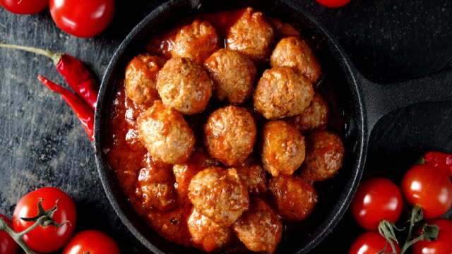 Fried the meatballs in frying pan slowly rotate. Fried the meatballs in frying pan slowly rotate. On a dark background. Top view. beef stock videos & royalty-free footage