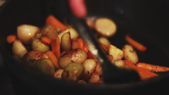 Fried vegetables on pan Fried vegetables on pan tuber stock videos & royalty-free footage