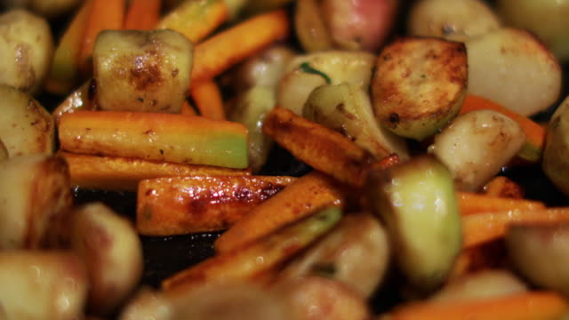 fried vegetables on pan - клубень стоковые видео и кадры b-roll