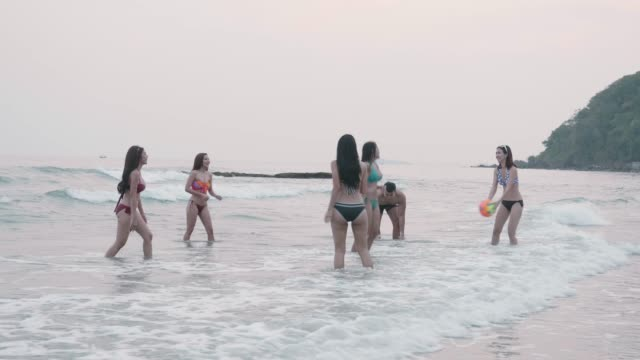 Friend group playing ball on the beach Friend group playing ball on the beach beach volleyball stock videos & royalty-free footage