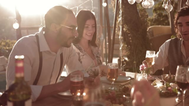 Friends and couples eating mediterranean lunch at rustic mountain cottage - video