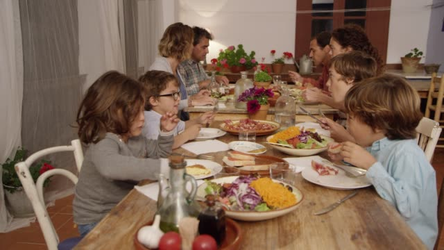 Friends and family having food at dining table