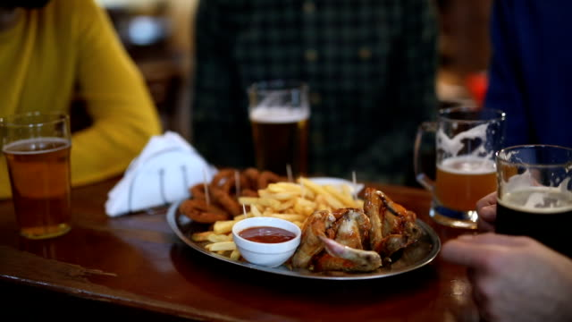 Friends at the pub Friends at the pub onion ring stock videos & royalty-free footage