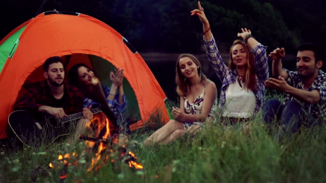 Friends camping by the lake video