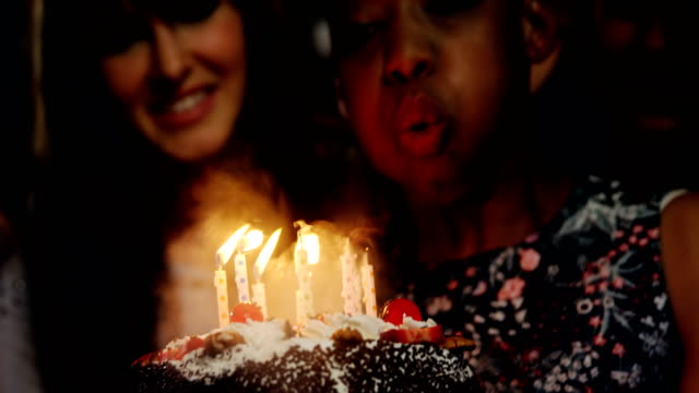 Friends celebrating birthday party in bar video
