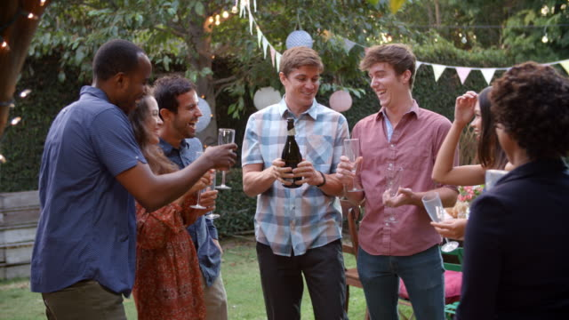 Friends Celebrating With Champagne At Outdoor Backyard Party video