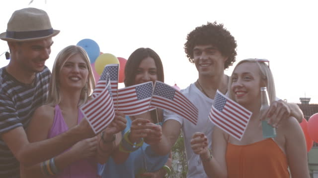 Friends cheering at fourth of July party video