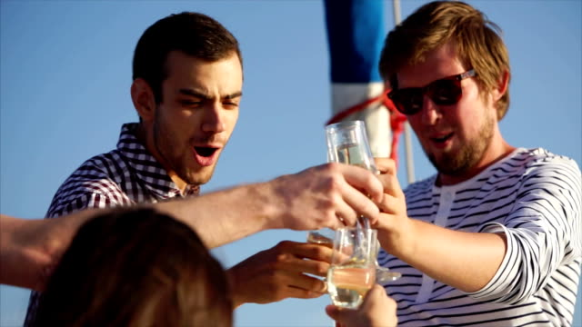 Friends clanging glasses during party on the yacht video