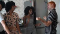 istock Friends dancing and having fun at kitchen 1138212902