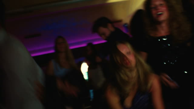 Friends dancing and singing together happily at a party video