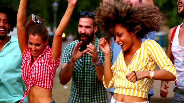 Friends dancing at a concert. video