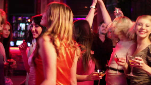 Friends Dancing At A Party Friends Enjoying Party At The ClubFriends Enjoying Party At The Club, dancing and drinking cocktails. Checkout this lightbox for more party videos party social event stock videos & royalty-free footage