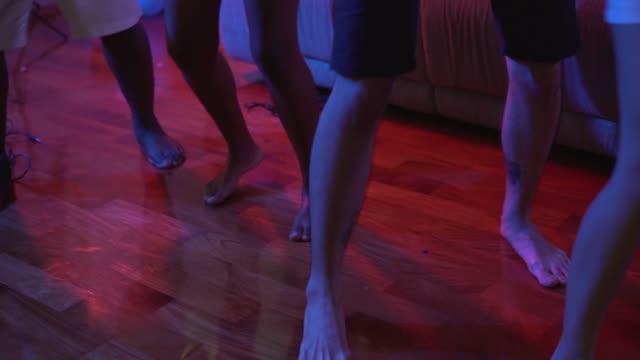 friends dancing together in the party - para aranżacja filmów i materiałów b-roll