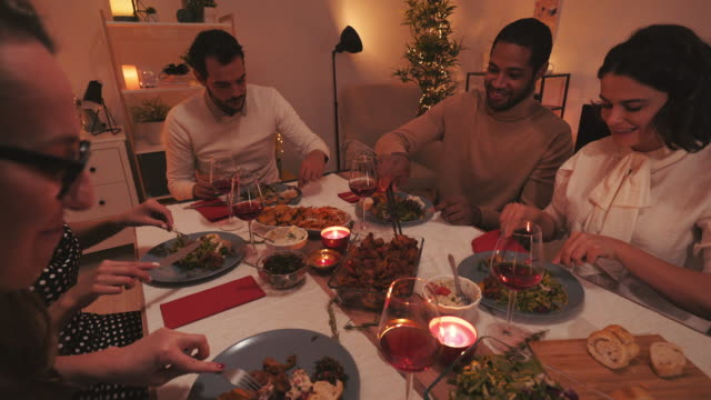 Friends dinning together during winter season.