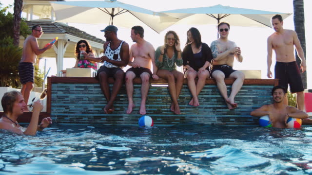 Friends Drinking on Poolside and Playing in Water video