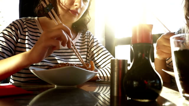 Friends Eating Noodles At Dining Table video
