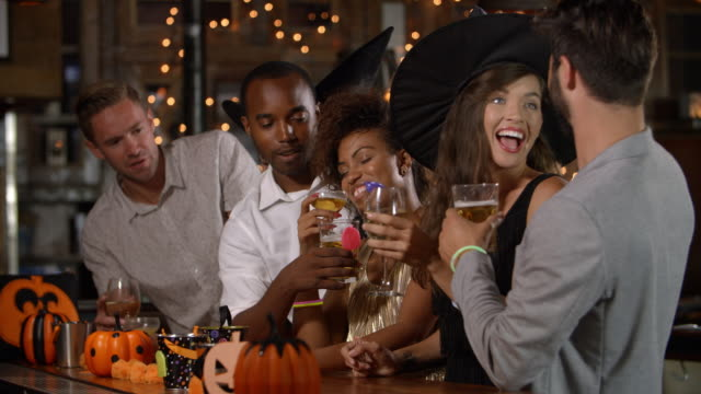 Friends enjoying a Halloween party at a bar video