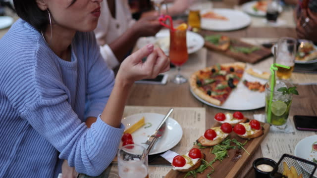 Friends enjoying brunch during weekend day at outdoor restaurant