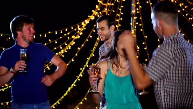 Friends enjoying night party with dancing and drinks video