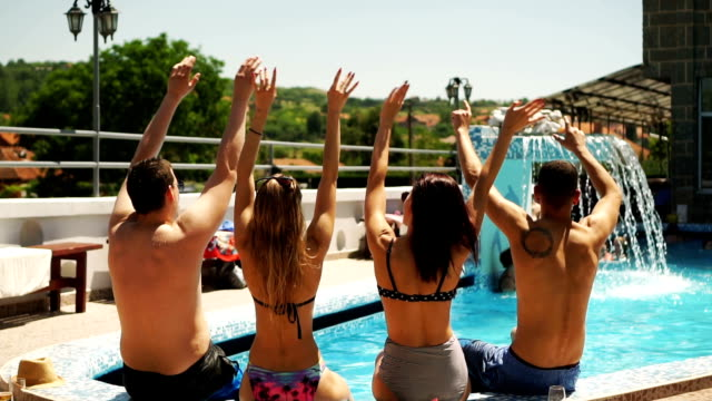 Friends enjoying on poolside Young people enjoying music on poolside. pool party stock videos & royalty-free footage