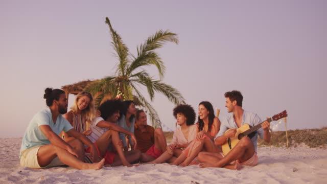 Friends enjoying on the beach