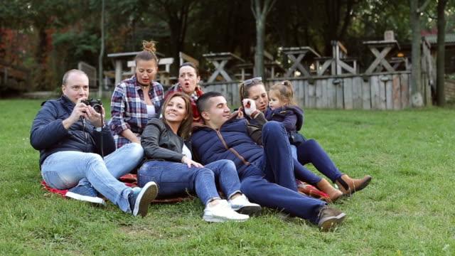 friends enjoying outside  - big family on vacation , city break video