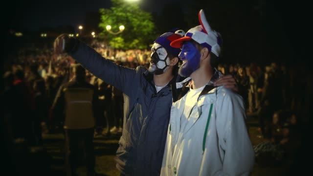 vídeos de stock e filmes b-roll de friends football fan make selfie smile background crowd during 4k sport match. - soccer supporter portrait