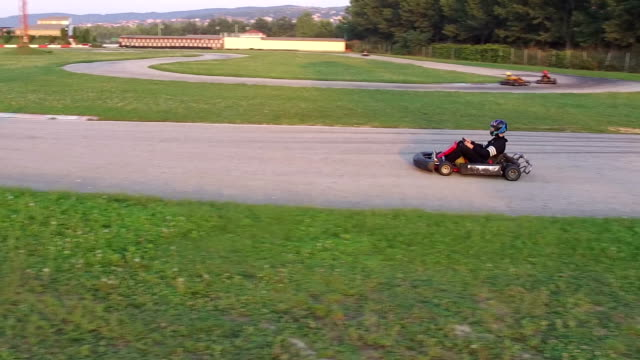 Friends have fun at go cart Friends have fun at go cart track go cart stock videos & royalty-free footage