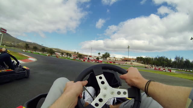 friends have fun while driving gokarts on Tenerife