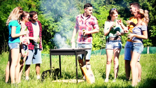 Friends having barbecue party. video