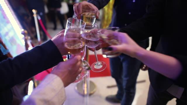 Friends having celebratory toast on fun party video