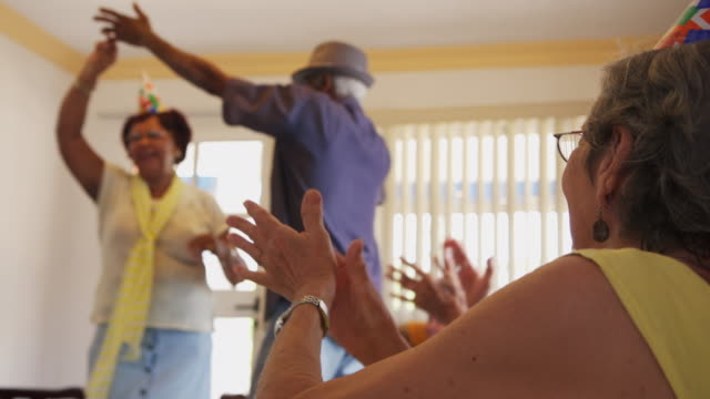 Friends Having Fun And Dancing At Birthday Party In Hospice video