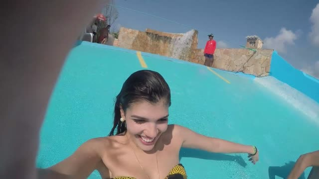 Friends having fun and sliding down in a water slide video