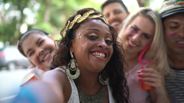 Friends having fun and taking a selfie at carnival party in Brazil Friends having fun and taking a selfie at carnival party in Brazil mardi gras stock videos & royalty-free footage