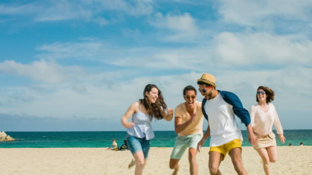 Friends having fun at the beach video