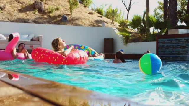 Friends Having Fun in Beautiful Outdoor Swimming Pool video
