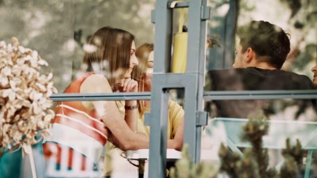 Friends in a retro cafe video