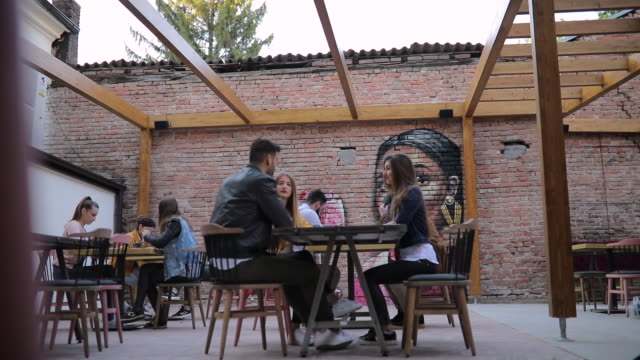 Friends in cafe outdoors video