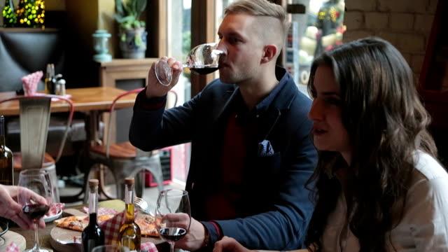 Friends in restaurant eating italian cuisines video