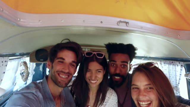 Friends in the back of a camper van on a trip taking selfie Friends in the back of a camper van on a trip taking selfie rv interior stock videos & royalty-free footage