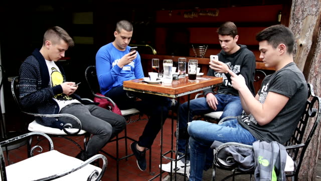 friends in the cafe using their phones - communication problems stock videos & royalty-free footage