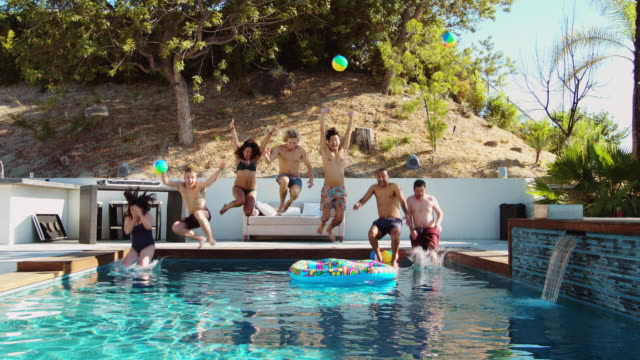 Friends Jumping into Swimming Pool video