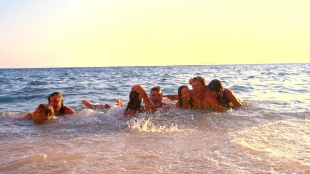 SLO MO Friends Lying In Shallow Water video