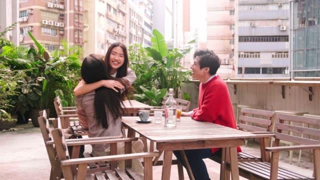 friends meeting in outdoor cafe in hong kong - terrazza video stock e b–roll