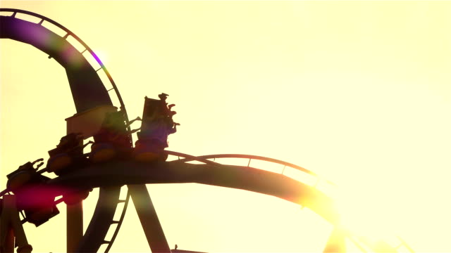 CLOSE UP: Friends on extreme roller coaster ride at sunset video
