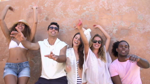 Friends On Holiday Dancing By Wall In Slow Motion video