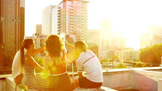 friends on rooftop deck - lifestyle stock videos & royalty-free footage