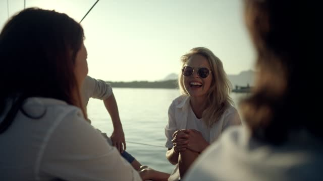 Friends on yacht Young people having fun on sailboat yacht stock videos & royalty-free footage