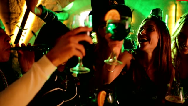 Friends partying and celebrating Saint Patrick's day at night club video