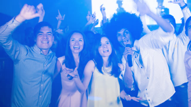 Friends partying at a karaoke bar video
